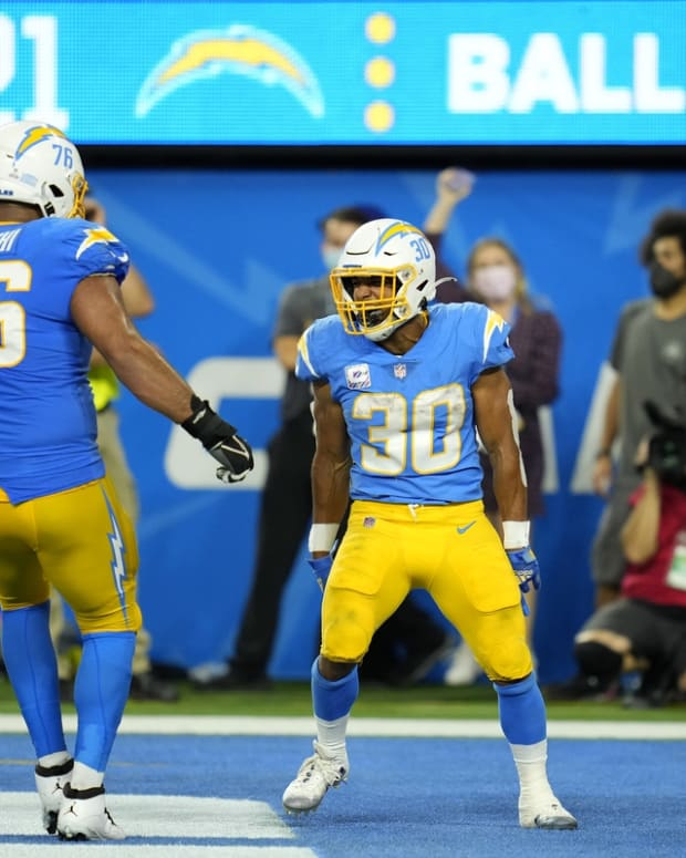 Oct 4, 2021; Inglewood, California, USA; Los Angeles Chargers running back Austin Ekeler (30) celebrates with offensive guard Oday Aboushi (76) after scoring a touchdown against the Las Vegas Raiders during the second half at SoFi Stadium. Mandatory Credit: Robert Hanashiro-USA TODAY Sports