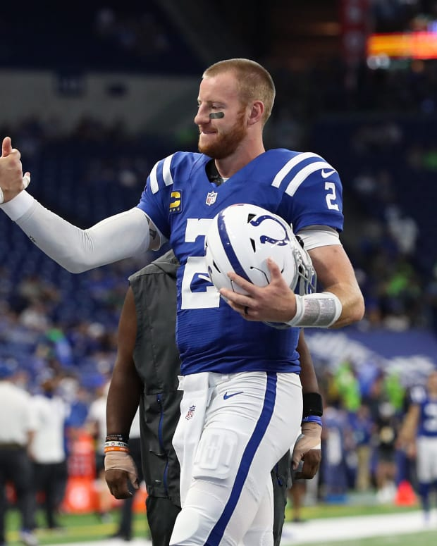 Indianapolis Colts center Ryan Kelly (78) and Indianapolis Colts quarterback Carson Wentz (2) meet on the field during warmups Sunday, Sept. 12, 2021, before the regular season opener against the Seattle Seahawks at Lucas Oil Stadium in Indianapolis.