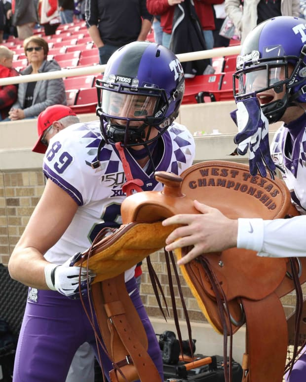 TCU Horned Frogs celebrate winning the West Texas Championship saddle in 2019.