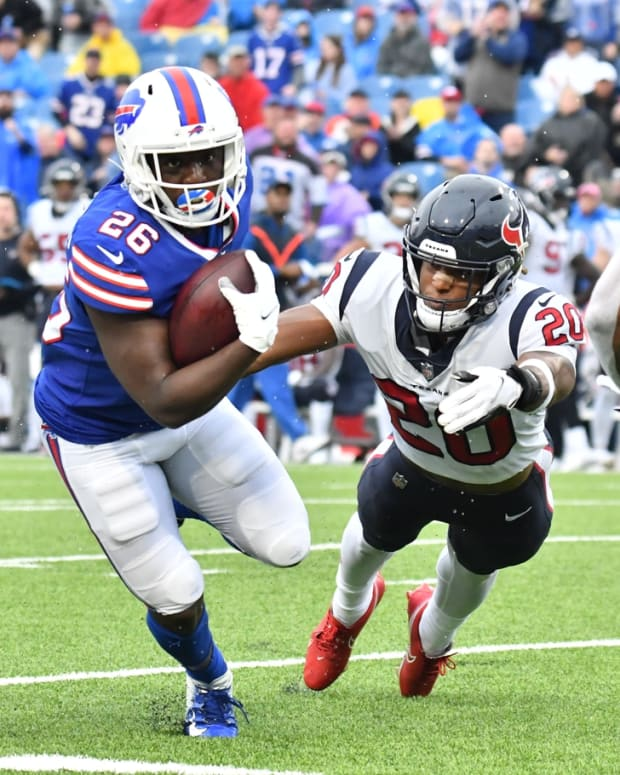 Oct 3, 2021; Orchard Park, New York, USA; Buffalo Bills running back Devin Singletary (26) avoids a tackle by Houston Texans strong safety Justin Reid (20) in the third quarter at Highmark Stadium. Mandatory Credit: Mark Konezny-USA TODAY Sports