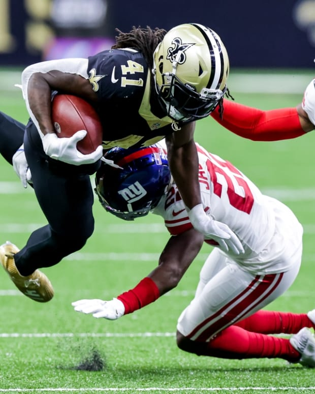 Oct 3, 2021; New Orleans, Louisiana, USA; New Orleans Saints running back Alvin Kamara (41) is tackled by New York Giants cornerback Josh Jackson (27) during the second half at Caesars Superdome. Mandatory Credit: Stephen Lew-USA TODAY Sports