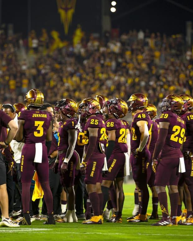 ASU team huddled