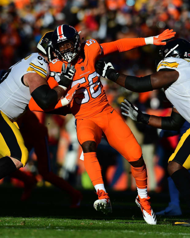 Denver Broncos outside linebacker Von Miller (58) is double blocked by Pittsburgh Steelers offensive guard David DeCastro (66) and offensive tackle Chuks Okorafor (76) in the first quarter at Broncos Stadium at Mile High.