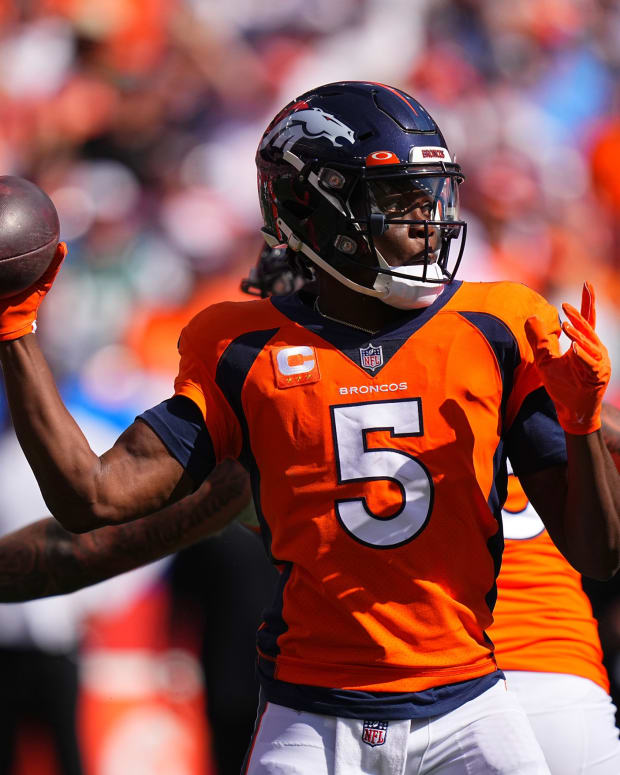 Denver Broncos quarterback Teddy Bridgewater (5) prepares to pass in the first quarter against the New York Jets at Empower Field at Mile High.