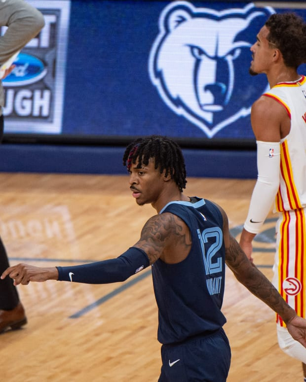 Memphis Grizzlies guard Ja Morant (12) and Atlanta Hawks guard Trae Young (11) during the game at FedExForum.