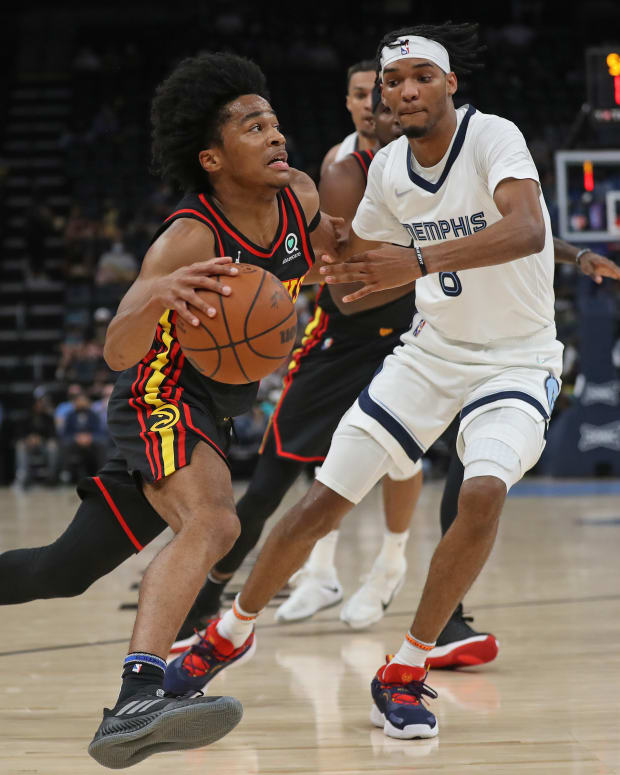 Atlanta Hawks guard Sharife Cooper (2) drives to the basket as Memphis Grizzles forward Ziaire Williams (8) defends during the first half at FedExForum.