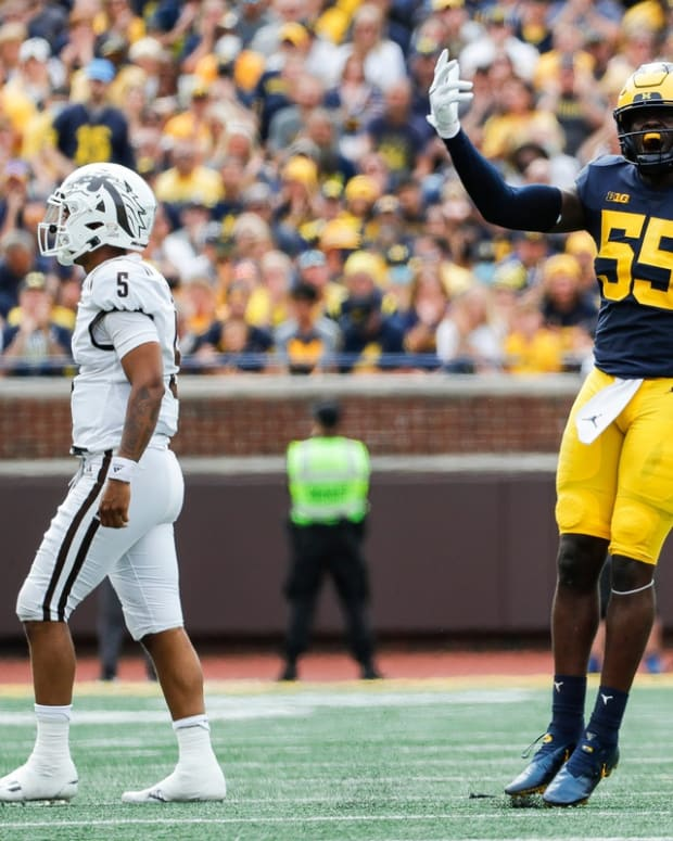 Michigan linebacker David Ojabo celebrates a tackle against Western Michigan during the first half in Ann Arbor on Saturday, Sept. 4, 2021.
