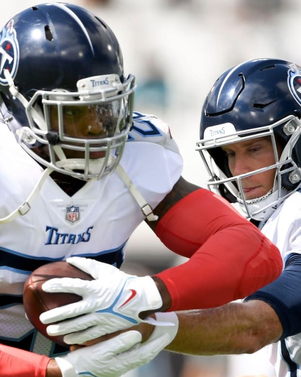 Tennessee Titans running back Derrick Henry (22) and quarterback Ryan Tannehill (17) warm up before facing the Jaguars at TIAA Bank Field Sunday, Oct. 10, 2021 in Jacksonville, Fla.