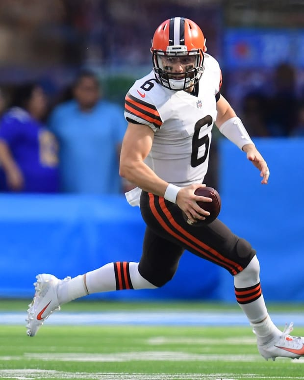 Oct 10, 2021; Inglewood, California, USA; Cleveland Browns quarterback Baker Mayfield (6) runs the ball against the Los Angeles Chargers during the second half at SoFi Stadium. Mandatory Credit: Gary A. Vasquez-USA TODAY Sports
