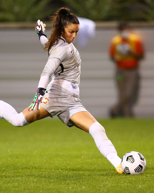 Goalkeeper Lysianne Proulx clears the ball out of the box