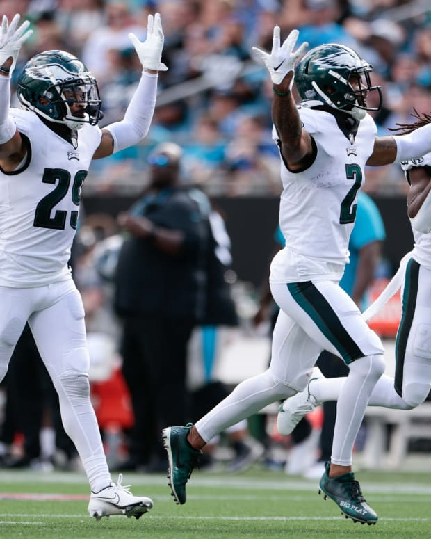 Eagles defense celebrates one of its three interceptions against the Carolina Panthers on Oct. 10, 2021