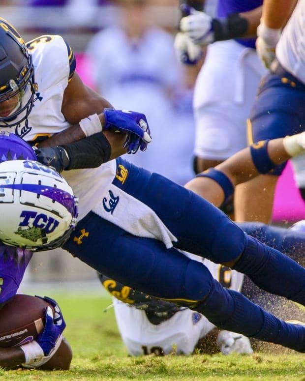 Safety Elijah Hicks makes a tackle against TCU