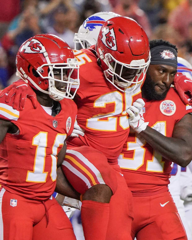 Oct 10, 2021; Kansas City, Missouri, USA; Kansas City Chiefs running back Clyde Edwards-Helaire (25) is carried off the field by wide receiver Tyreek Hill (10) and running back Darrel Williams (31) after an injury against the Buffalo Bills during the second half at GEHA Field at Arrowhead Stadium. Mandatory Credit: Denny Medley-USA TODAY Sports