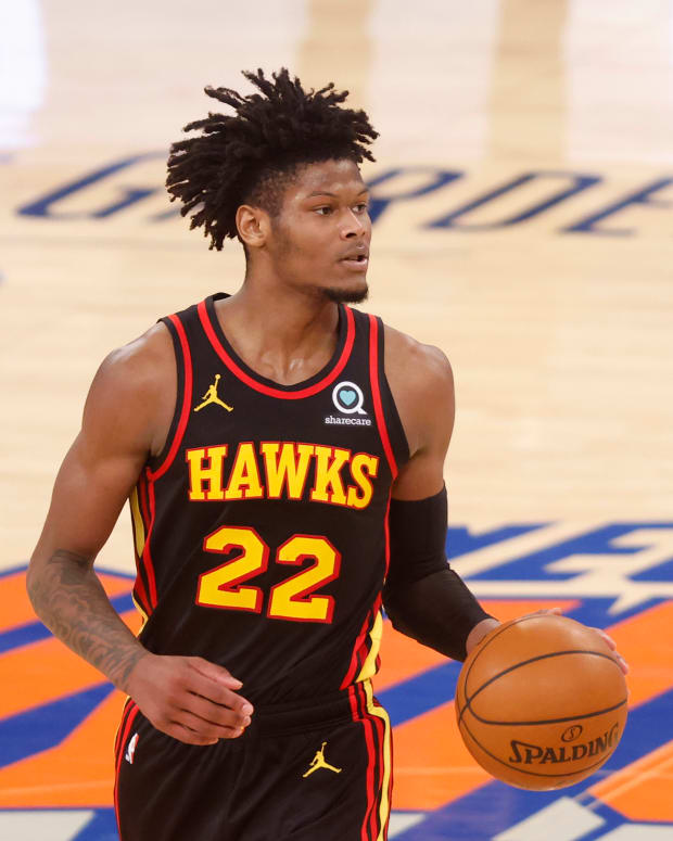 Atlanta Hawks' Cam Reddish (22) controls the ball against the New York Knicks during the fourth quarter at Madison Square Garden.