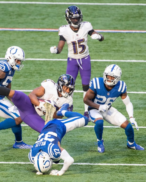 Nov 8, 2020; Indianapolis, Indiana, USA; Baltimore Ravens running back Mark Ingram (21) runs the ball against Indianapolis Colts strong safety Khari Willis (37) and cornerback Rock Ya-Sin (26) in the second half at Lucas Oil Stadium.