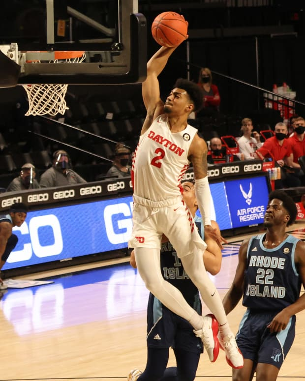 Dayton Flyers guard Ibi Watson (2) dunks the ball as Rhode Island Rams center Makhel Mitchell (22) looks on in the first half in the second round of the 2021 Atlantic 10 Conference Tournament at Stuart C. Siegel Center.