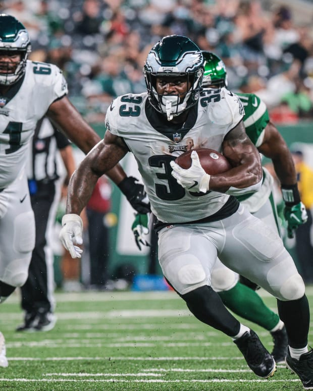 Aug 27, 2021; East Rutherford, New Jersey, USA; Philadelphia Eagles running back Elijah Holyfield (33) carries the ball as New York Jets defensive tackle Michael Dwumfour (50) pursues in front of swqtackle Le Raven Clark (61) during the second half at MetLife Stadium. Mandatory Credit: Vincent Carchietta-USA TODAY Sports