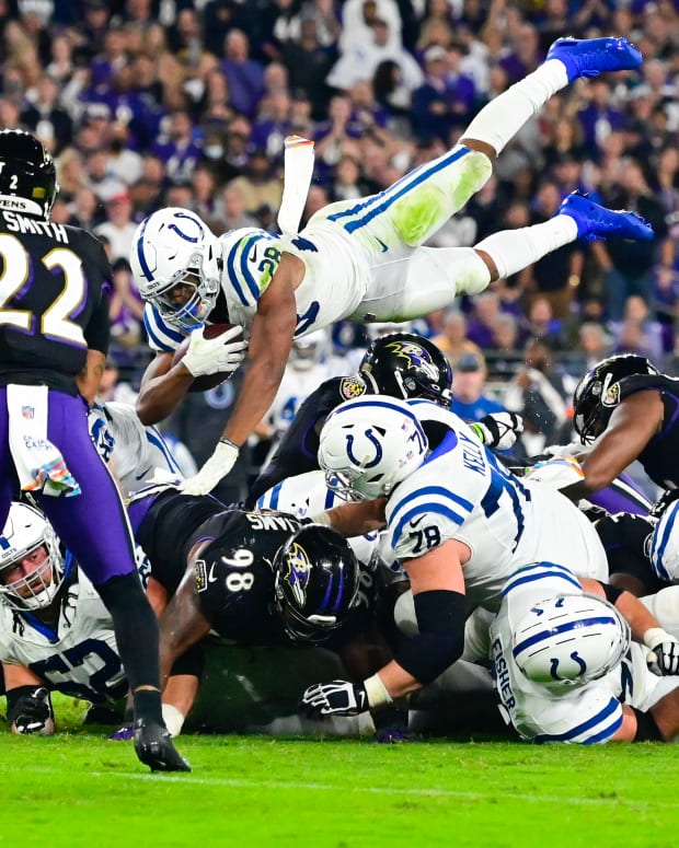 Oct 11, 2021; Baltimore, Maryland, USA; Indianapolis Colts running back Jonathan Taylor (28) dives over the pile for a first down during the fourth quarter against the Baltimore Ravens at M&T Bank Stadium.
