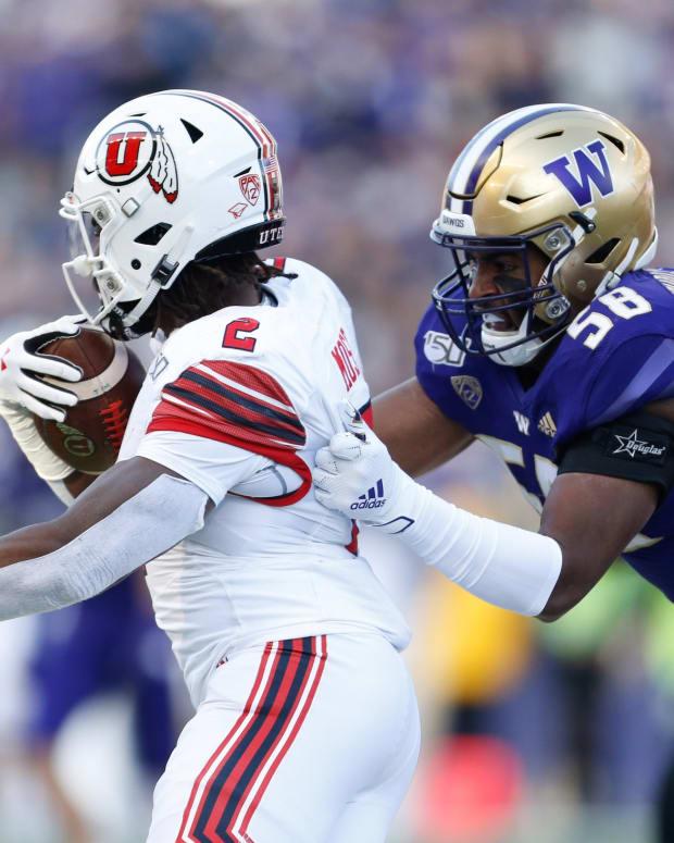Zion Tupuola-Fetui pulls down Utah's Zack Moss in 2020.