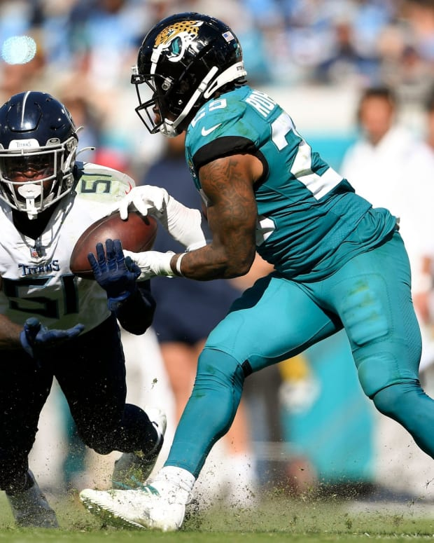 Tennessee Titans linebacker David Long Jr. (51) defends a pass intended for Jacksonville Jaguars running back James Robinson (25) during the fourth quarter of the game at TIAA Bank Field Sunday, Oct. 10, 2021 in Jacksonville, Fla.