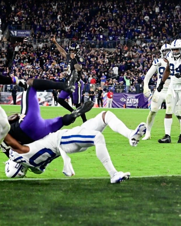 Oct 11, 2021; Baltimore, Maryland, USA; Baltimore Ravens quarterback Lamar Jackson (8) celebrates as wide receiver Marquise Brown (5) is tackles in the end zone for a touchdown by Indianapolis Colts defensive back George Odum (30) in overtime at M&T Bank Stadium.