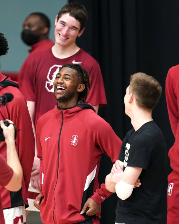 Daejon Davis reacts to video message during his Stanford senior day moment.