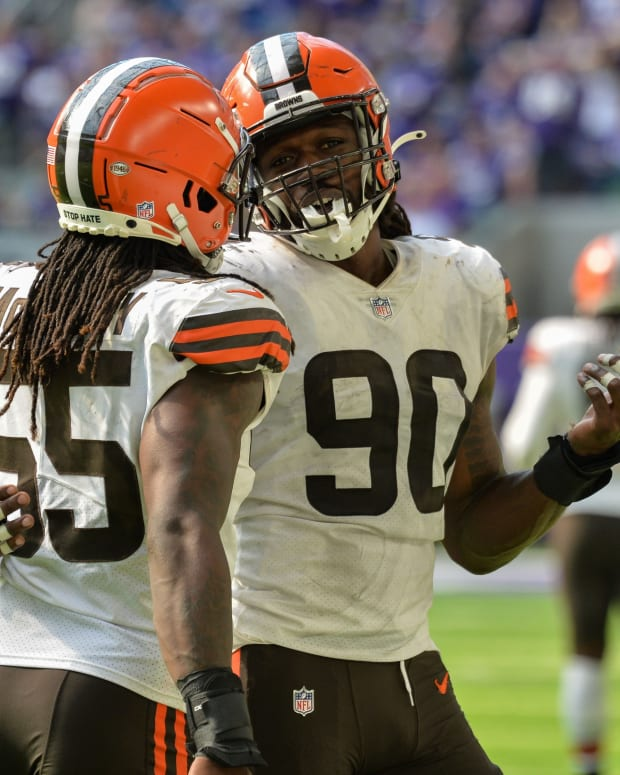 Oct 3, 2021; Minneapolis, Minnesota, USA; Cleveland Browns defensive end Jadeveon Clowney (90) and defensive end Takkarist McKinley (55) react during the fourth quarter against the Minnesota Vikings at U.S. Bank Stadium. Mandatory Credit: Jeffrey Becker-USA TODAY Sports