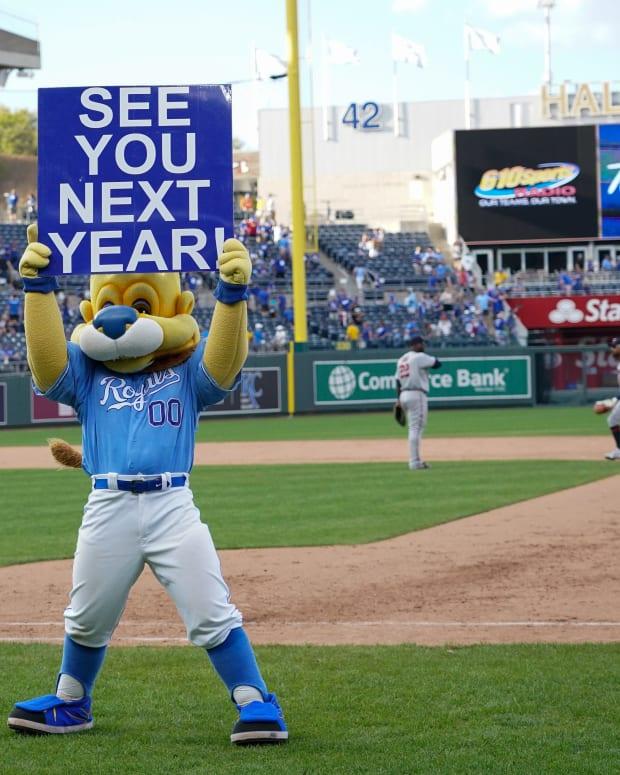 Oct 3, 2021; Kansas City, Missouri, USA; The Kansas City Royals mascot Sluggerrr displays a sign to the fans after the loss to the Minnesota Twins at Kauffman Stadium. Mandatory Credit: Denny Medley-USA TODAY Sports