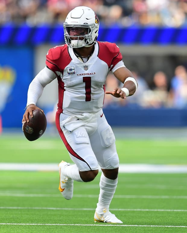 Oct 3, 2021; Inglewood, California, USA; Arizona Cardinals quarterback Kyler Murray (1) moves out to pass against the Los Angeles Rams during the first half at SoFi Stadium. Mandatory Credit: Gary A. Vasquez-USA TODAY Sports