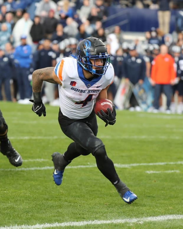 Oct 9, 2021; Provo, Utah, USA; Boise State Broncos running back Cyrus Habibi-Likio (4) runs the ball in for a touchdown during the second quarter against the Brigham Young Cougars at LaVell Edwards Stadium. Mandatory Credit: Rob Gray-USA TODAY Sports