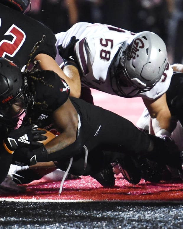 Oct 2, 2021; Cheney, WA, USA; Eastern Washington Eagles running back Silas Perreiah (22) dives into the end zone for a touchdown against the Montana Grizzlies in the second half at Roos Field. Mandatory Credit: James Snook-USA TODAY Sports
