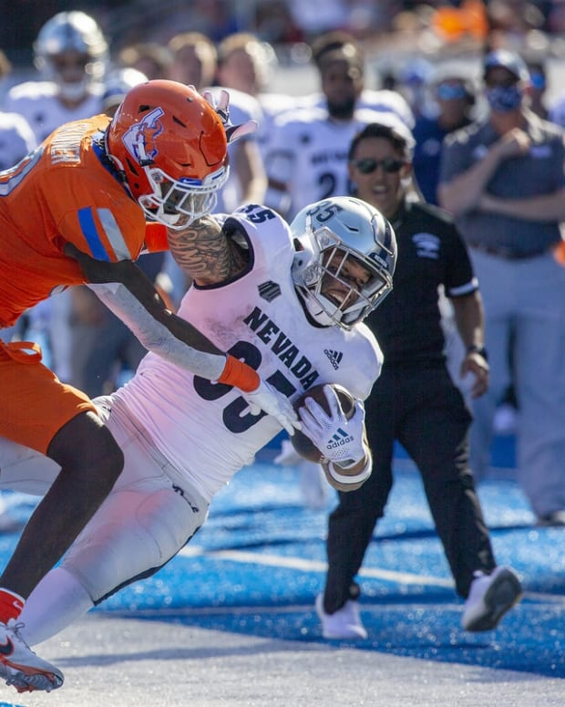 Oct 2, 2021; Boise, Idaho, USA; Boise State Broncos safety JL Skinner (0) knocks Nevada Wolf Pack running back Toa Taua (35) out of bounds during the second half at Albertsons Stadium. Mandatory Credit: Brian Losness-USA TODAY Sports