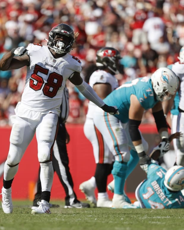 Oct 10, 2021; Tampa, Florida, USA; Tampa Bay Buccaneers outside linebacker Shaquil Barrett (58) sacks Miami Dolphins quarterback Jacoby Brissett (14) during the second half at Raymond James Stadium. Mandatory Credit: Kim Klement-USA TODAY Sports