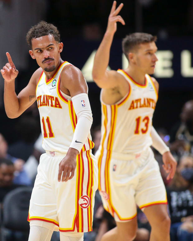 Atlanta Hawks guard Trae Young (11) celebrates after a three pointer with guard Bogdan Bogdanovic (13) against the Miami Heat in the first half at State Farm Arena.