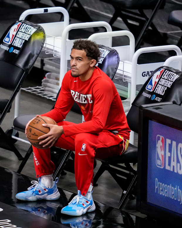 Atlanta, Georgia, USA; Atlanta Hawks guard Trae Young (11) sits on the bench prior to the game against the Milwaukee Bucks during game three of the Eastern Conference Finals for the 2021 NBA Playoffs at State Farm Arena.