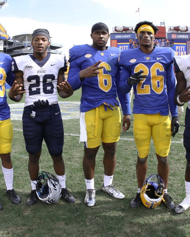 Sep 25, 2021; Pittsburgh, Pennsylvania, USA; Former Delaware state high school football players and current New Hampshire Wildcats running back Carlos Washington Jr. (26) and wide receiver Charles Briscoe III (5) along with Pittsburgh Panthers defensive back Myles Canton (39) and defensive lineman John Morgan III (6) and defensive back Judson Tallandier (26) pose for a photo following the game at Heinz Field. Mandatory Credit: Charles LeClaire-USA TODAY Sports