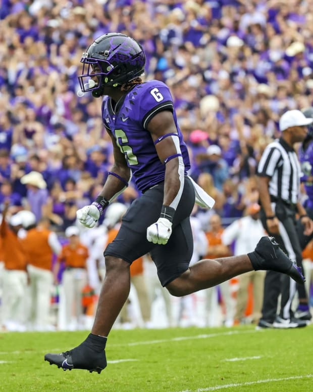Oct 2, 2021; Fort Worth, Texas, USA; TCU Horned Frogs running back Zach Evans (6) reacts after scoring a touchdown during the first quarter against the Texas Longhorns at Amon G. Carter Stadium. Mandatory Credit: Kevin Jairaj-USA TODAY Sports