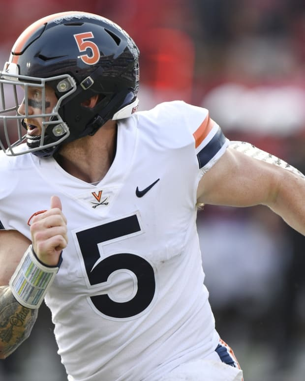Oct 9, 2021; Louisville, Kentucky, USA; Virginia Cavaliers quarterback Brennan Armstrong (5) scrambles with the ball against the Louisville Cardinals during the second half at Cardinal Stadium. Virginia defeated Louisville 34-33. Mandatory Credit: Jamie Rhodes-USA TODAY Sports