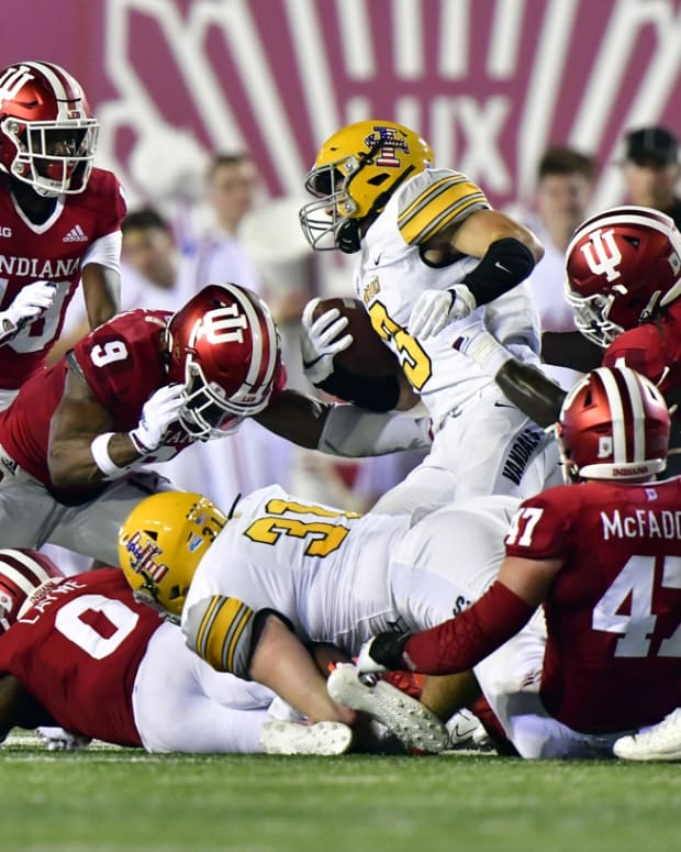 Sep 11, 2021; Bloomington, Indiana, USA; Idaho Vandals running back Nick Romano (3) is tackled by the Indiana Hoosiers during the second quarter at Memorial Stadium. Mandatory Credit: Marc Lebryk-USA TODAY Sports