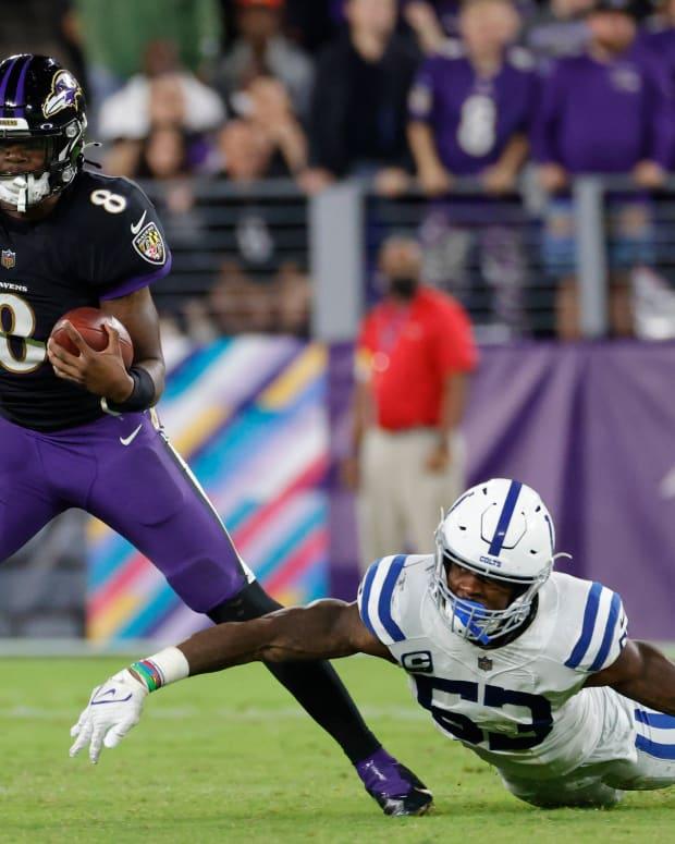 Oct 11, 2021; Baltimore, Maryland, USA; Baltimore Ravens quarterback Lamar Jackson (8) runs with the ball past Indianapolis Colts outside linebacker Darius Leonard (53) chases during the third quarter at M&T Bank Stadium. Mandatory Credit: Geoff Burke-USA TODAY Sports