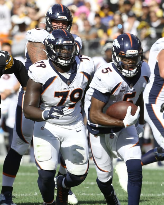 Oct 10, 2021; Pittsburgh, Pennsylvania, USA; Denver Broncos quarterback Teddy Bridgewater (5) scrambles with the ball against the Pittsburgh Steelers during the fourth quarter at Heinz Field. The Steelers won 27-19. Mandatory Credit: Charles LeClaire-USA TODAY Sports