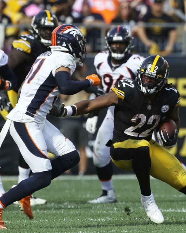 Oct 10, 2021; Pittsburgh, Pennsylvania, USA; Pittsburgh Steelers running back Najee Harris (22) carries the ball against Denver Broncos free safety Justin Simmons (31) during the third quarter at Heinz Field. The Steelers won 27-19. Mandatory Credit: Charles LeClaire-USA TODAY Sports