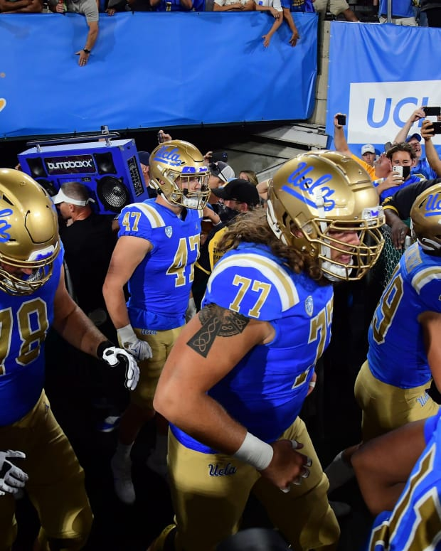 The Bruins take the field at the Rose Bowl.