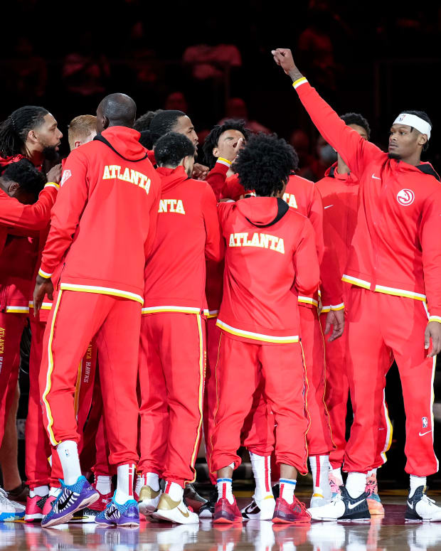 Atlanta Hawks players huddle before playing the Cleveland Cavaliers at State Farm Arena.