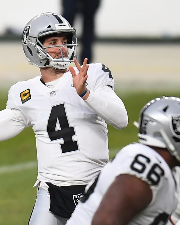Las Vegas Raiders quarterback Derek Carr (4) throws a pass against the Denver Broncos during the second quarter at Empower Field at Mile High.