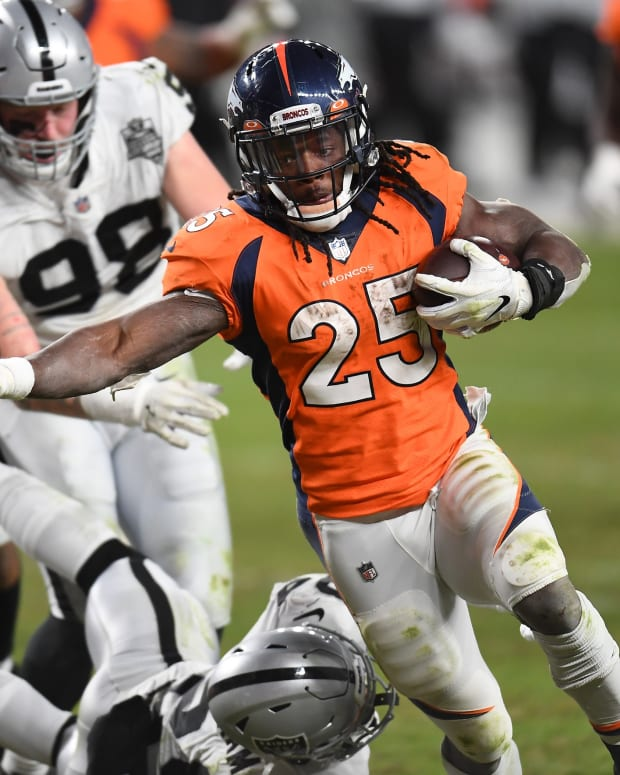 Denver Broncos running back Melvin Gordon (25) scores a touchdown in the fourth quarter against the Las Vegas Raiders at Empower Field at Mile High.