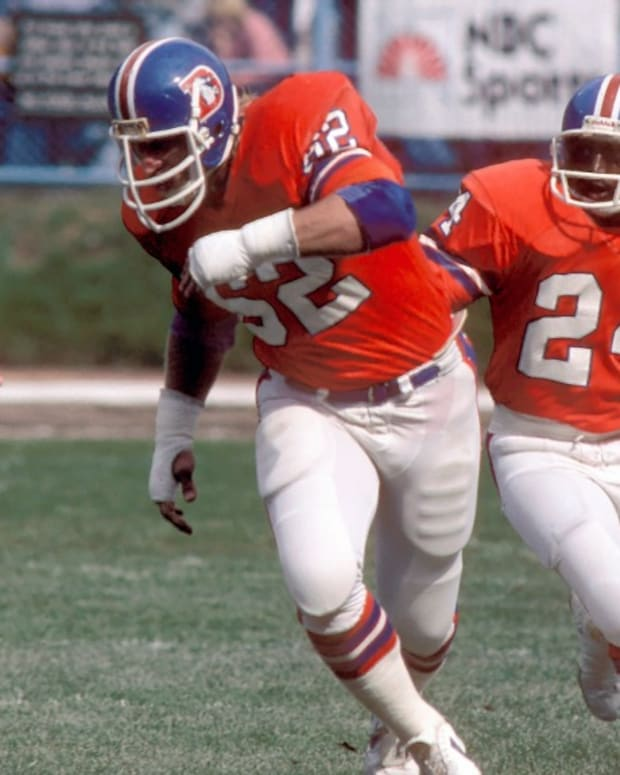 Denver Broncos running back (24) Otis Armstrong is led by offensive lineman (62) Tom Glassic against the Cleveland Browns at Cleveland Municipal Stadium.