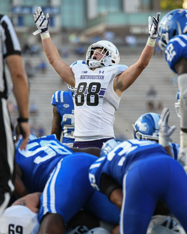 Sep 18, 2021; Durham, North Carolina, USA; Northwestern Wildcats tight end Marshall Lang (88) celebrates a touchdown during the third quarter at Wallace Wade Stadium. Mandatory Credit: William Howard-USA TODAY Sports