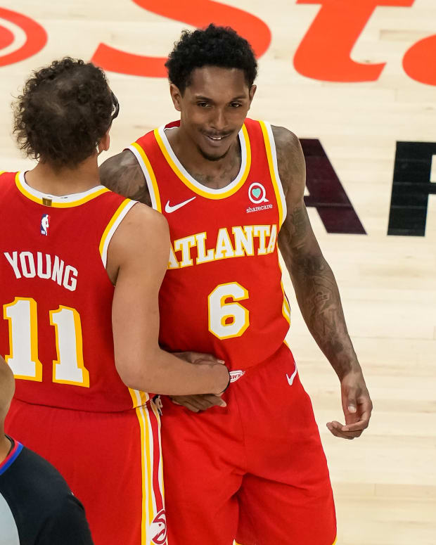 Atlanta Hawks guard Trae Young (11) and guard Lou Williams (6) react after a play against the Orlando Magic during the second half at State Farm Arena.
