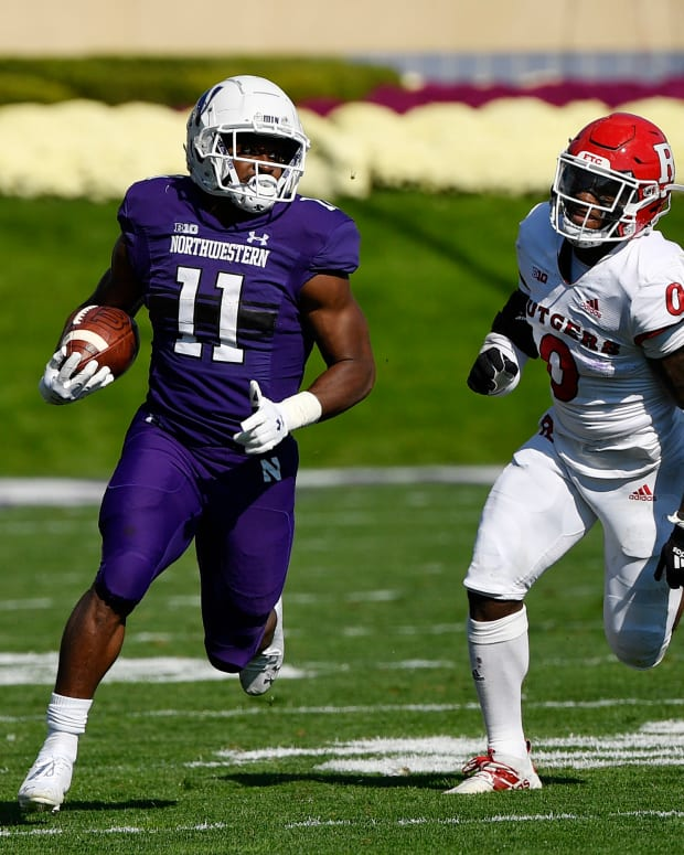Oct 16, 2021; Evanston, Illinois, USA; Northwestern Wildcats running back Andrew Clair (11) runs with the football in the first half against Rutgers Scarlet Knights defensive back Christian Izien (0) at Ryan Field. Mandatory Credit: Quinn Harris-USA TODAY Sports